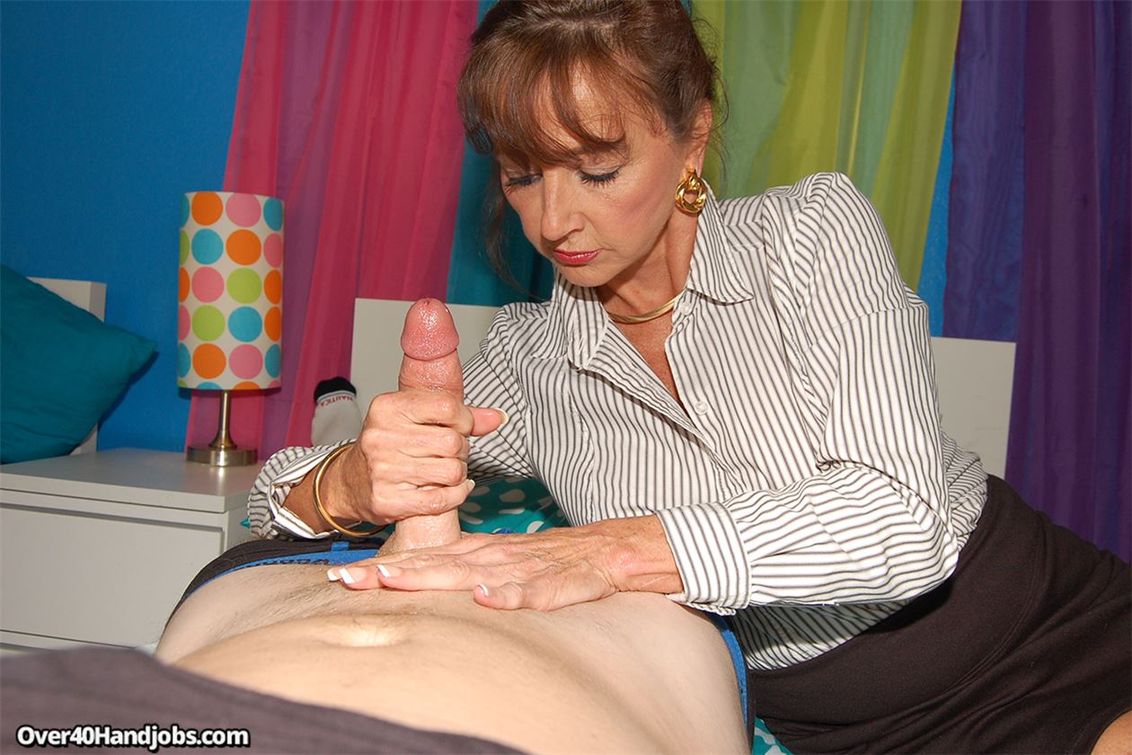 Mature women milking